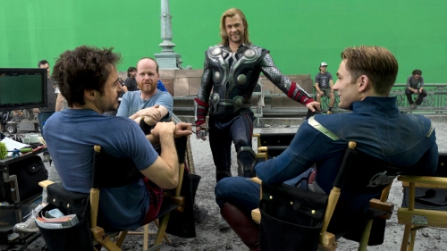 "Courtesy Walt Disney Pictures Robert Downey Jr., Joss Whedon, Chris Hemsworth and Chris Evans enjoy a relaxed moment during shooting of ""Marvel's The Avengers."""