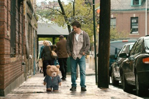 "Photo Credit: Universal Pictures/Tippett StudioJohn (MARK WAHLBERG) walks his best friend, Ted (voiced by SETH MACFARLANE), to a job interview in the live action/CG-animated comedy ""Ted."""