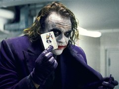 The Dark Knight Heath Ledger Joker holding a card