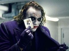 The Dark Knight Heath Ledger Joker holding a card
