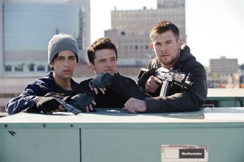 "Film DistrictMatt (Josh Lucas), Robert (Josh Hutcherson) and Jed (Chris Hemsworth) get ready for a shoot-out in ""Red Dawn."""