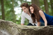 Andrew Cooper/Summit EntertainmentEdward (Robert Pattinson) shows Bella (Kristen Stewart) the tricks of being a vampire.