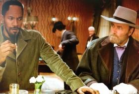 Django (Jamie Foxx) encounters a bar patron (Franco Nero)