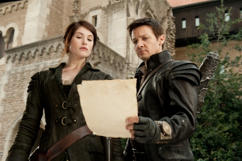 "David Appleby/Paramount Pictures Gretel (Gemma Arterton) and Hansel (Jeremy Renner) learn their next target in ""Hansel and Gretel Witch Hunters."""