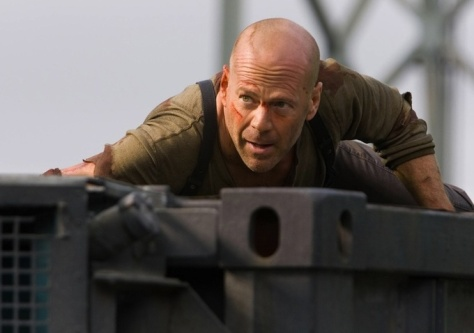 Bruce Willis as John McClaine on tank in Live Free or Die Hard