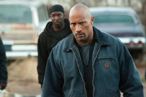 "Steve Dietl/Summit Entertainment Malik (Michael Williams) watches John (Dwayne Johnson) in ""Snitch."""