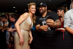 Caroline McCredie/Getty Images Adrianne Palicki and a fan.