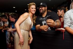 Caroline McCredie/Getty Images Adrianne Palicki and a fan.