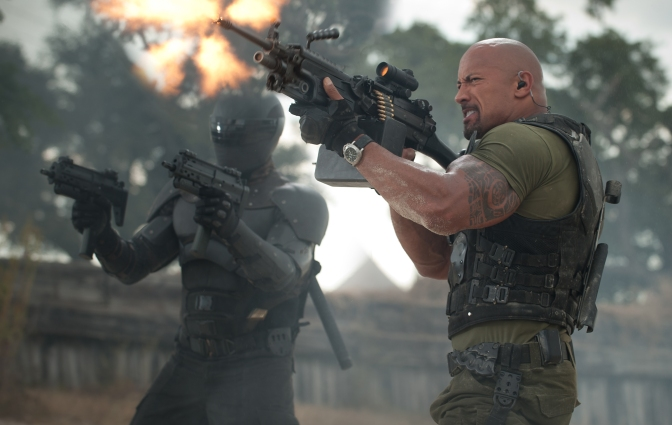 Jamie Trueblood/Paramount Pictures Snake-Eyes (Ray Park) and Roadblock (Dwayne Johnson) in a shoot out.