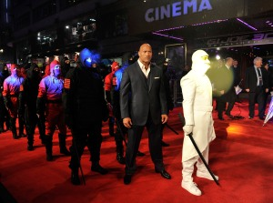 Gareth Cattermole/Getty ImagesDwayne Johnson flanked by ninjas.