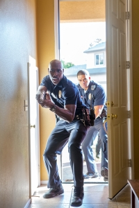 Greg Gayne/Sony PicturesOfficer Phillips (Morris Chestnut) and Officer Devans (David Otunga) try to find Casey.