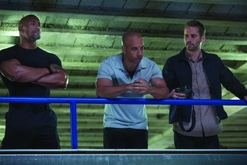 Giles Keyte/Universal Pictures Hobbs (Dwayne Johnson), Dom (Vim Diesel) and Brian (Paul Walker) reunite.