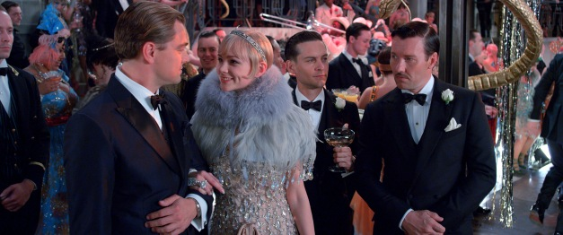 "Warner Bros. Pictures Jay Gatsby (Leonardo DiCaprio) entertains Daisy (Carey Mulligan), Nick (Tobey Maguire) and Tom (Joel Edgerton) in ""The Great Gatsby."""