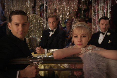 Warner Bros. Pictures Nick Carraway (Tobey Maguire), Jay Gatsby (Leonardo DiCaprio), Daisy (Carey Mulligan) and Tom Buchanan (Joel Edgerton) relax.