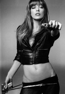 Milla Jovovich with gun