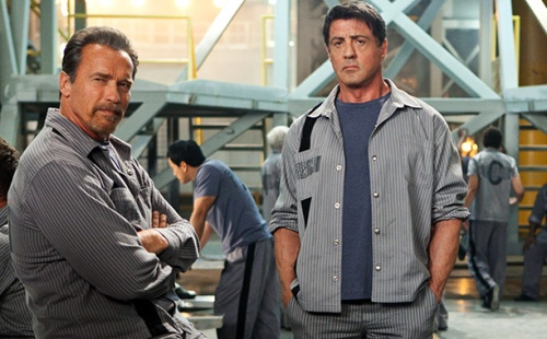 "Alan Markfield/Summit Entertainment Arnold Schwarzenegger and Sylvester Stallone star in ""Escape Plan."""
