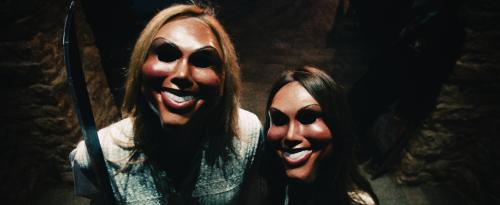 """Universal Pictures Psychotic celebrants prepare to attack the Sandin family in """"The Purge"""", a speculative thriller that follows one family over the course of a single night to see how far they will go to protect themselves when the vicious outside world breaks into their home."""