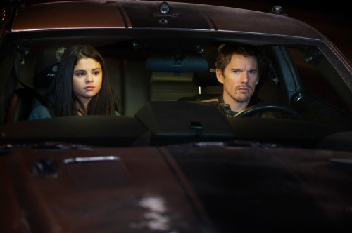 "Simon Versano/Warner Bros. Pictures Selena Gomez as The Kid and Ethan Hawke as Brent Magna in Dark Castle Entertainment's and After Dark Films' action thriller ""GETAWAY."""