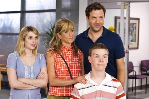 "Michael Tackett/Warner Bros. Pictures Emma Roberts as Casey Mathis, Jennifer Aniston as Rose O'Reilly, Jason Sudekis as David Clark and Will Poulter as Kenny Rossmore in ""We're the Millers."""