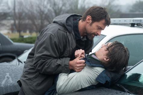 Wilson Webb/Warner Bros. Pictures Keller Dover (Hugh Jackman) confronts Alex Jones (Paul Dano).