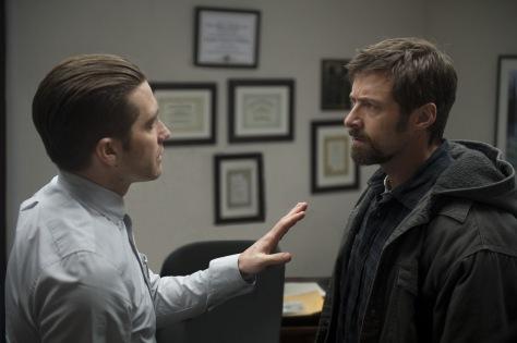 Wilson Webb/Warner Bros. Pictures Detective Loki (Jake Gyllenhaal) tries to calm Keller Dover (Hugh Jackman).