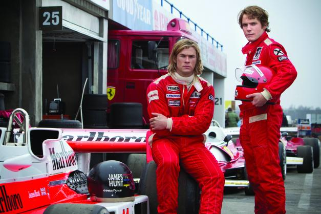 "Jaap Buitendijk/Universal Studios Chris Hemsworth as the charismatic Englishman James Hunt and Daniel Bruhl as disciplined Austrian perfectionist Niki Lauda in ""Rush."""