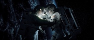 Courtesy of Warner Bros. Pictures Ryan Stone (Sandra Bullock) clings on to Matt Kowalski (George Clooney).