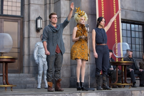 "Murray Close/Lionsgate Publicity Katniss Everdeen (Jennifer Lawrence), Effie Trinket (Elizabeth Banks) and Peeta Mellark (Josh Hutcherson) in ""The Hunger Games: Catching Fire."""