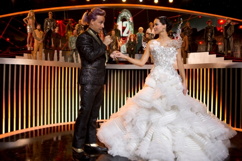 """Murray Close/Lionsgate Publicity Caesar Flickerman (Stanley Tucci) and Katniss Everdeen (Jennifer Lawrence) in """"The Hunger Games: Catching Fire."""""""