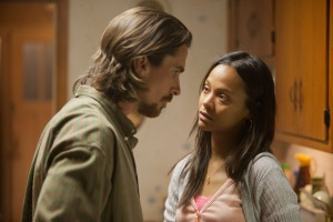 Kerry Hayes/Relativity Media Russell (Christian Bale) and Lena (Zoe Saldana) talk things over.