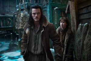 Mark Pokorny/Warner Bros. Pictures LUKE EVANS as Bard and JOHN BELL as Bain.