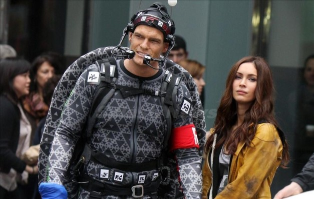 "Alan Ritchson in his Raphael motion capture suit with Megan Fox in ""Teenage Mutant Ninja Turtles."""