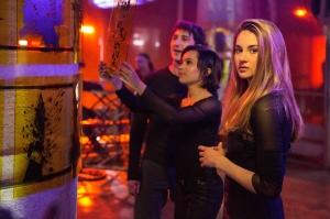 Jaap Buitendijk/Summit Entertainment, LLC. Will (Ben Lloyd Hughes), Christina (Zoe Kravitz) and Tris (Shailene Woodley) enjoy a night out.