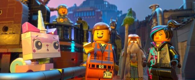 Courtesy of Warner Bros. Pictures LEGO® characters Unikitty (voiced by Alison Brie), Benny (Charlie Day), Emmet (Chris Pratt), Batman (Will Arnett), Vitruvius (Morgan Freeman) and Wyldstyle (Elizabeth Banks).