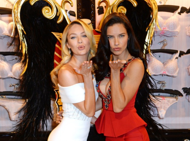 David M. Benett/Getty Images Victoria's Secret Angels Adriana Lima and Candice Swanepoel speak at the New Bond Street store on April 15, 2014 in London, England.