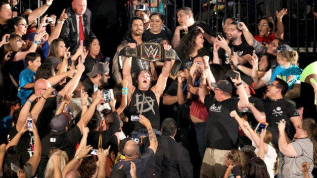 WWE Elimination Chamber 2015 - Ambrose and Reigns celebrate