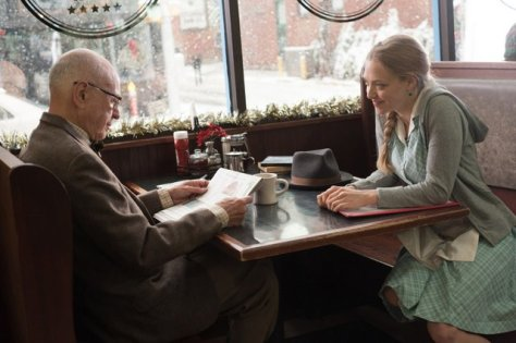 (Left to right) Alan Arkin and Amanda Seyfried in LOVE THE COOPERS to be released by CBS Films and Lionsgate.