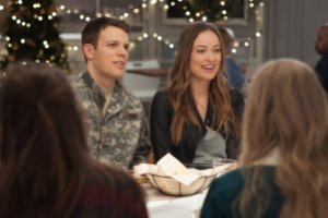 (Left to right) Jake Lacy and Olivia Wilde in LOVE THE COOPERS to be released by CBS Films and Lionsgate