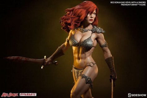 Red Sonja - She Devil with a Sword premium format -holding sword wide shot