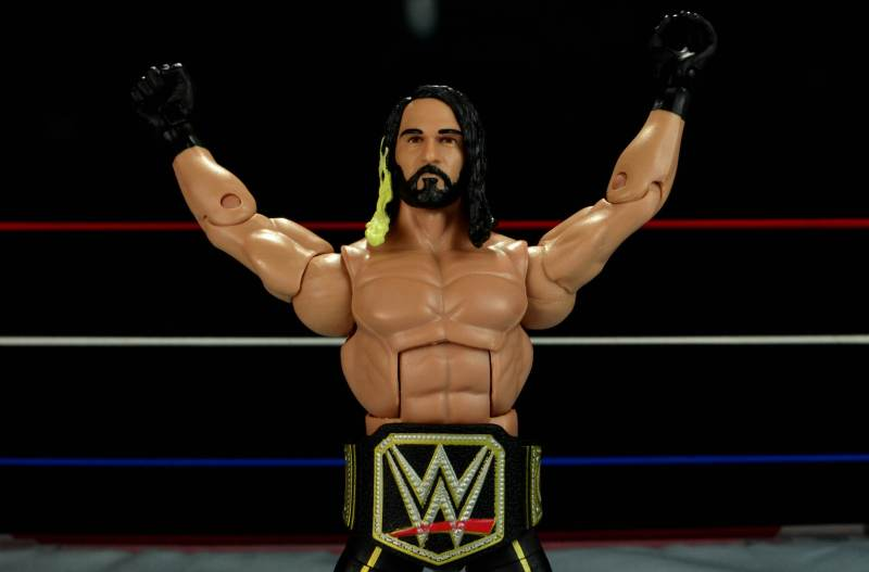 Seth Rollins Mattel exclusive -hands up wearing title belt