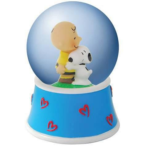 Snoopy hugging Charlie Brown